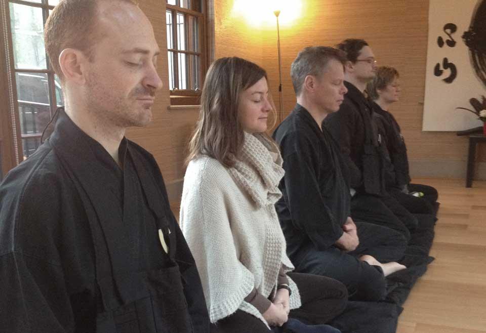 Sitting in zazen (meditation)